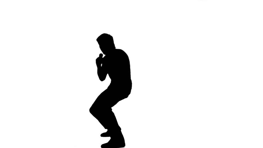 852x480 A Silhouette Energetic Man Is Holding A Microphone Against A White