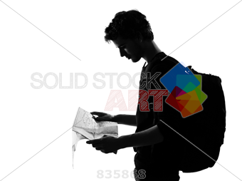 340x254 Stock Photo Of Young Man Silhouette Backpacker Reading Map