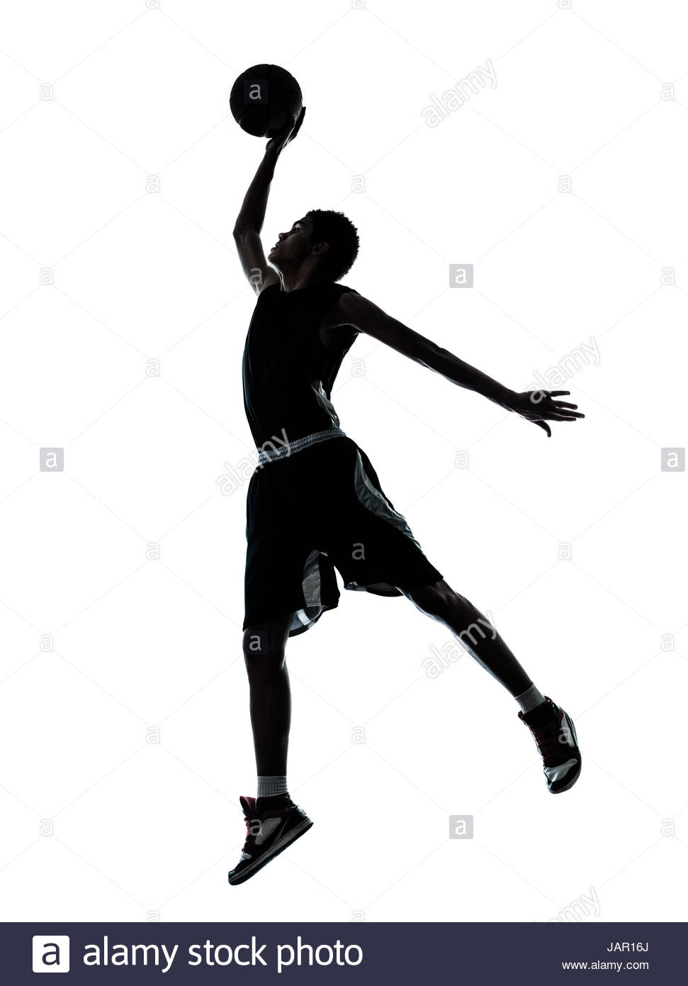 971x1390 One Young Man Basketball Player Dunking Silhouette In Studio