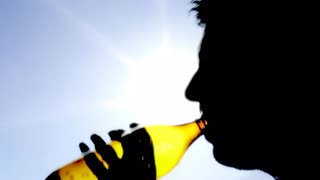 320x180 Silhouette Sun Beer Big Heaven. Bearded Man Drinking Beer