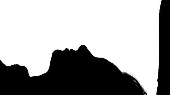 590x332 Girl Is Lying On The Bed With Her Kissing Guy. Silhouette. White