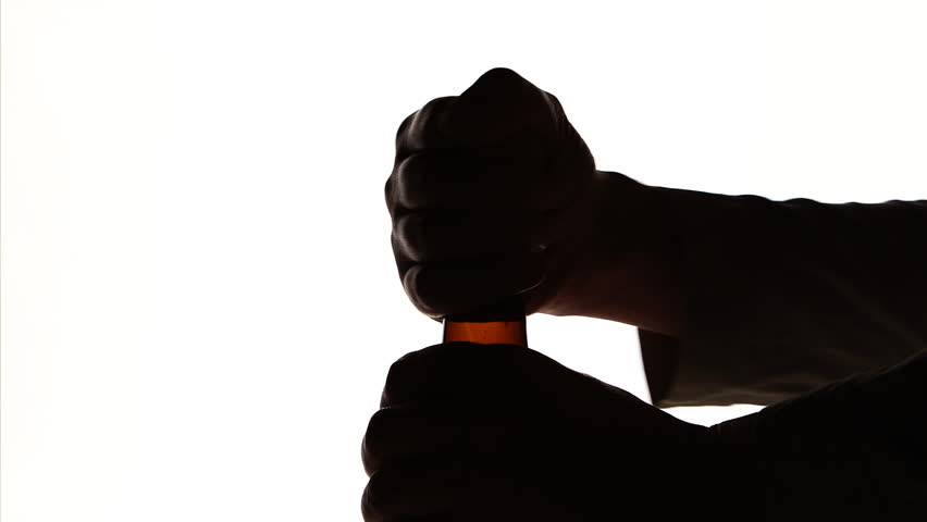 852x480 The Silhouette Of Male Hands Opening Brown Beer Bottle Stock