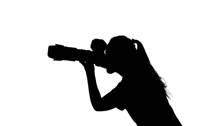 852x480 Photographer Works In The Studio. White. Silhouette Stock Footage