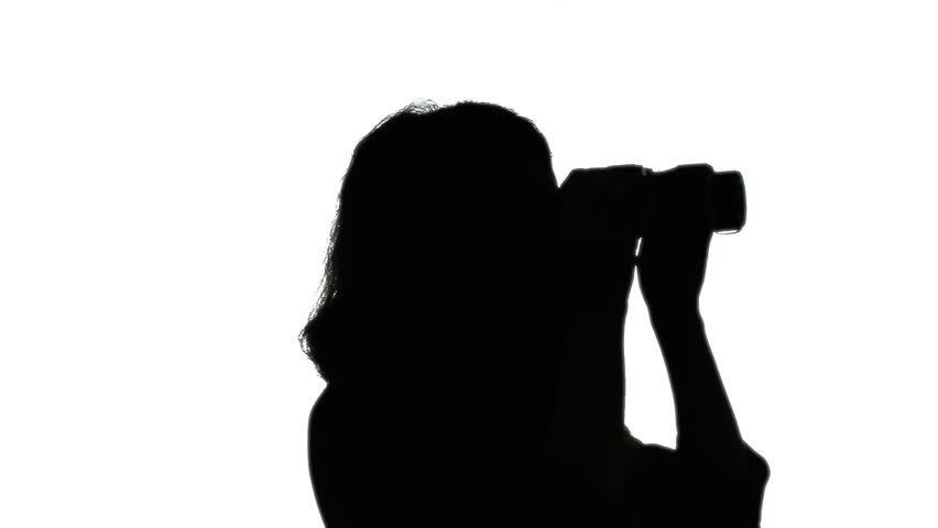 852x480 Silhouette Shot A Woman Looking Through A Pair Of Binoculars
