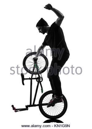 300x421 One Man Exercising Bmx Acrobatic Figure In Silhouette Studio Stock