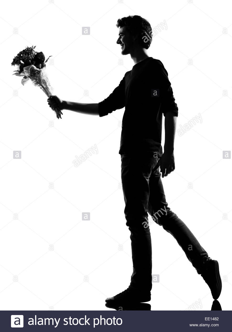 971x1390 Young Man Offering Flowers Bouquet Silhouette In Studio Isolated