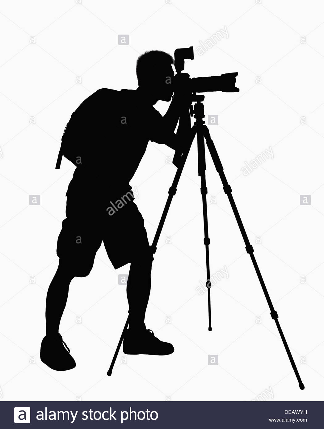 1049x1390 Silhouette Of Man Taking Pictures With Camera On Tripod Stock