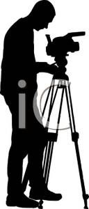 128x300 Silhouette Of A Photographer Setting Up His Camera For A Photo