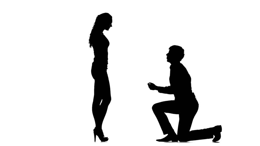 852x480 Silhouette Of Man On One Knee And Kissing Woman's Hand. In Full