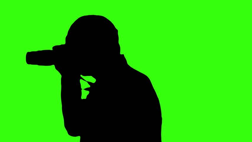 852x480 The Silhouette Of A Woman Aiming A Gun Around. Cinema Film Strip