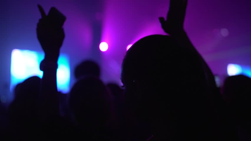 852x480 Girl Sitting On Shoulders At Concert In Crowd In Silhouette