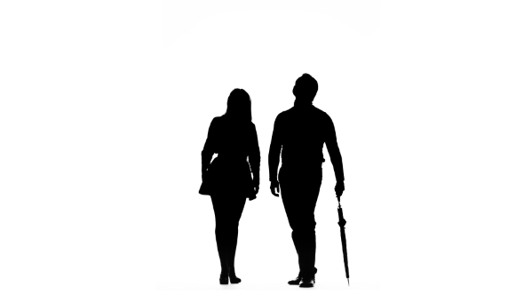 590x332 Guy And The Girl Are Kissing Under The Umbrella. Silhouette. White