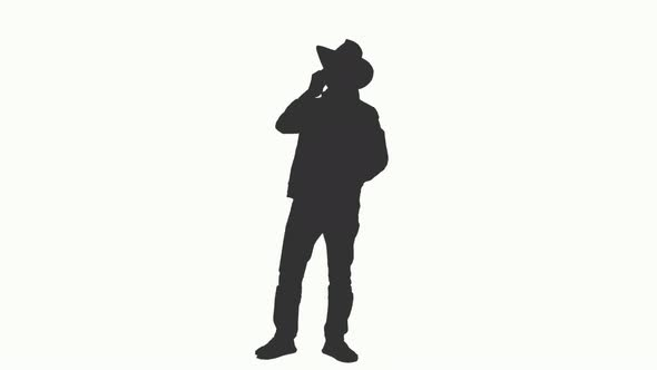 590x332 Silhouette Of A Man In Cowboy Hat Talking On Smartphone, Alpha