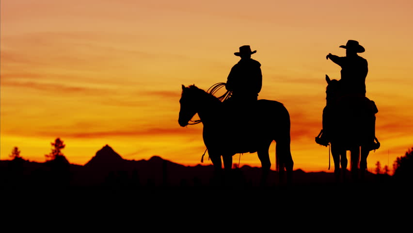 852x480 Silhouette Sunset Of Cowboy Riders In The Wilderness Stock Footage