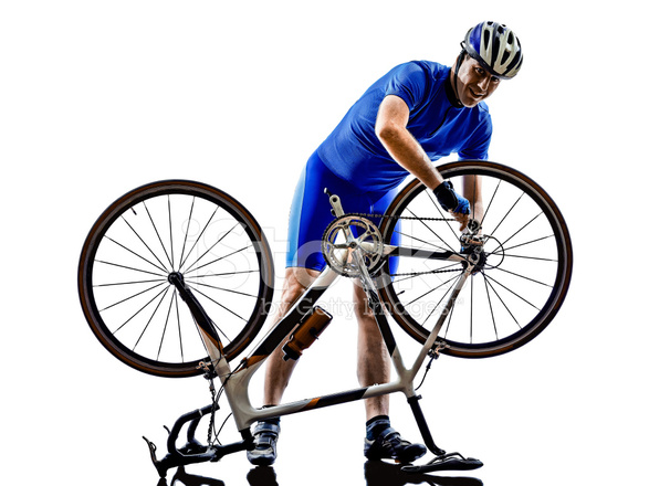 587x440 Cyclist Repairing Bicycle Silhouette Stock Photos