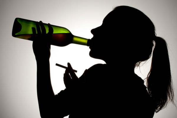 600x400 Silhouette Of Woman Drinking Wine With Cigarette