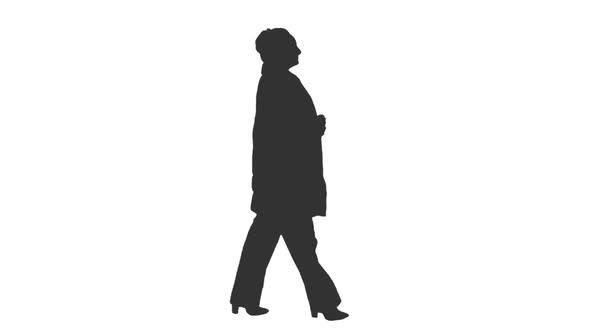 590x332 Silhouette Of An Elegant Woman Walking In The Street, Alpha