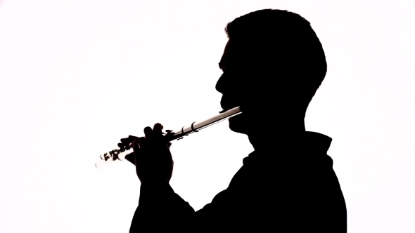 590x332 Isolated Silhouette Of A Guy Playing The Flute By Envatoreal