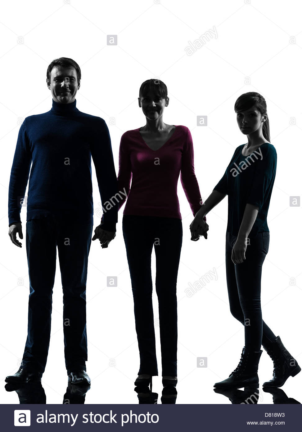973x1390 One Family Father Mother Daughter Man Holding Hands In Silhouette