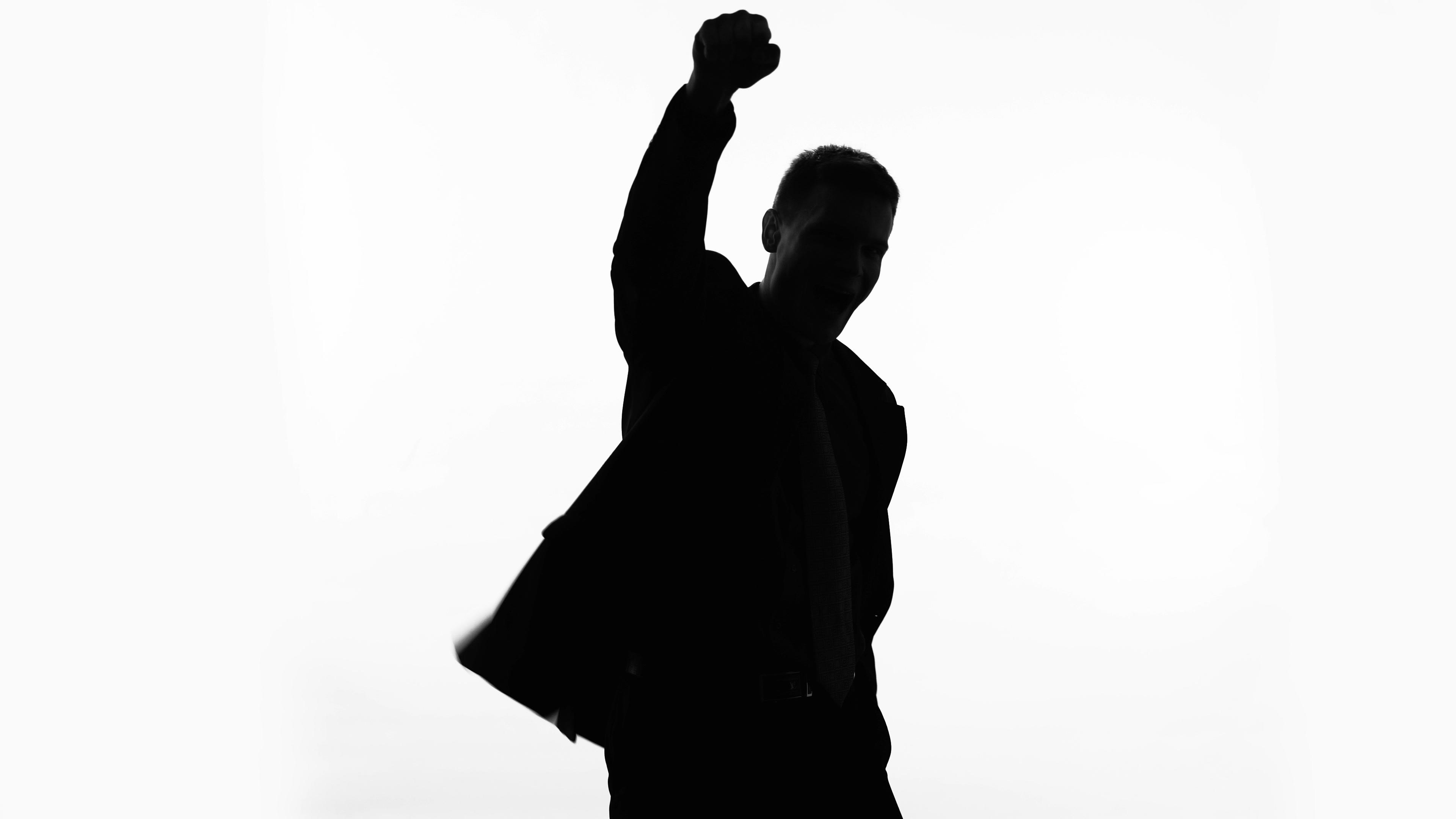 3840x2160 Businessman Silhouette Raises Fist Up, Celebrates Success, Proud
