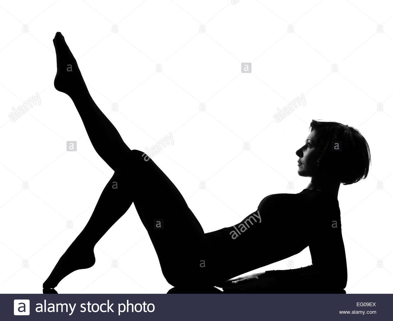 1300x1061 Woman Exercising Lying On Back Fitness Yoga Stretching In Shadow