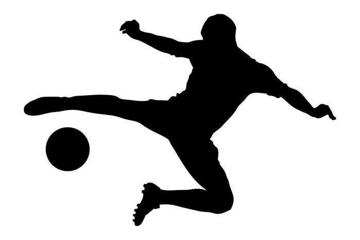 700x467 A Silhouette Of A Soccer Player Shooting A Ball Wall Mural