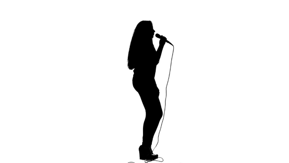 590x332 Girl Dances To The Beat Of Her Song. White Background. Silhouette