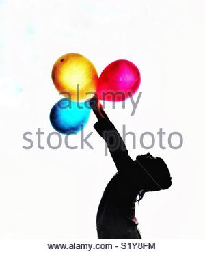 300x370 Silhouette Of A Girl Holding Bunch Of Balloons Stock Photo