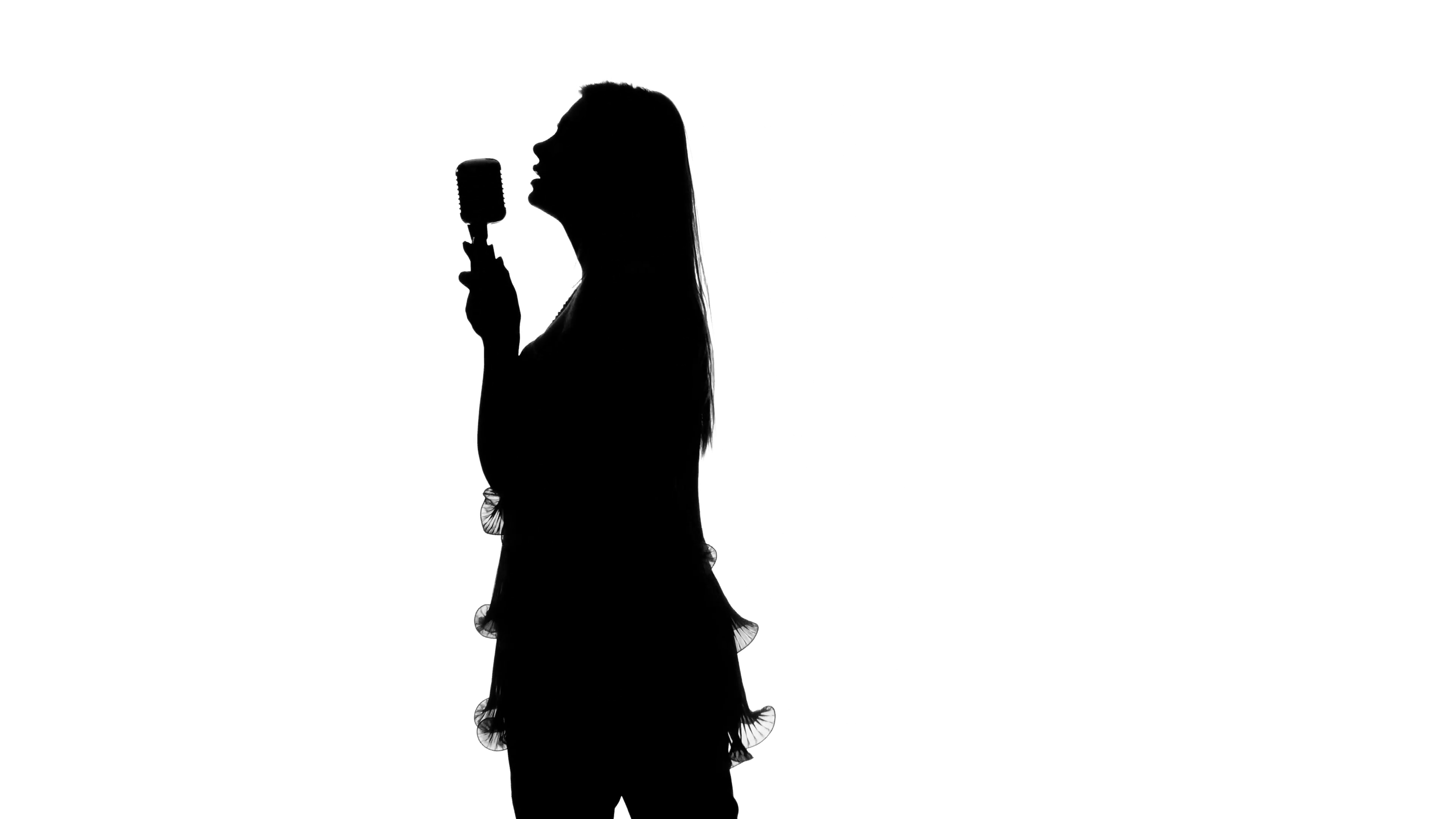 3840x2160 Girl In Short Dress Singing The Song In The Hall. Silhouette