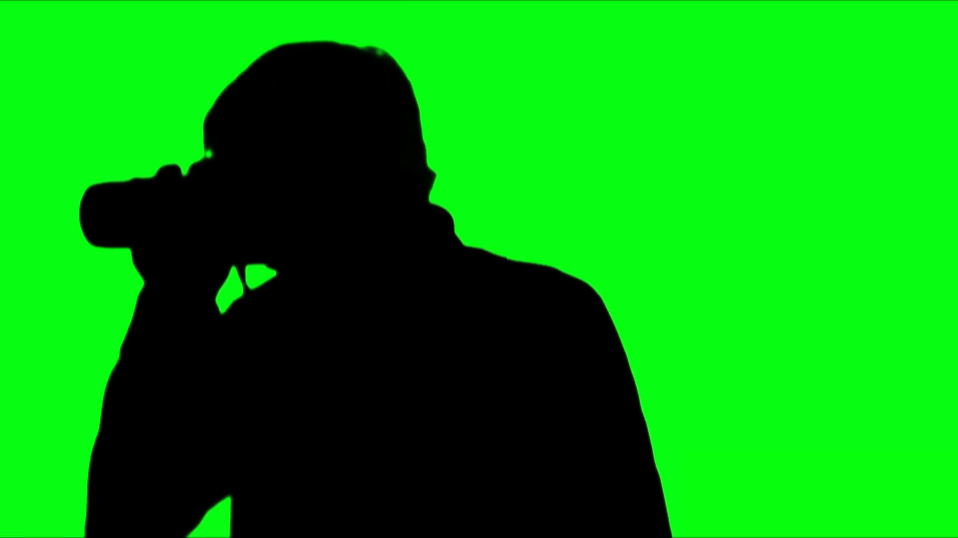 1920x1080 Photographer Silhouette Against Green Stock Video Footage