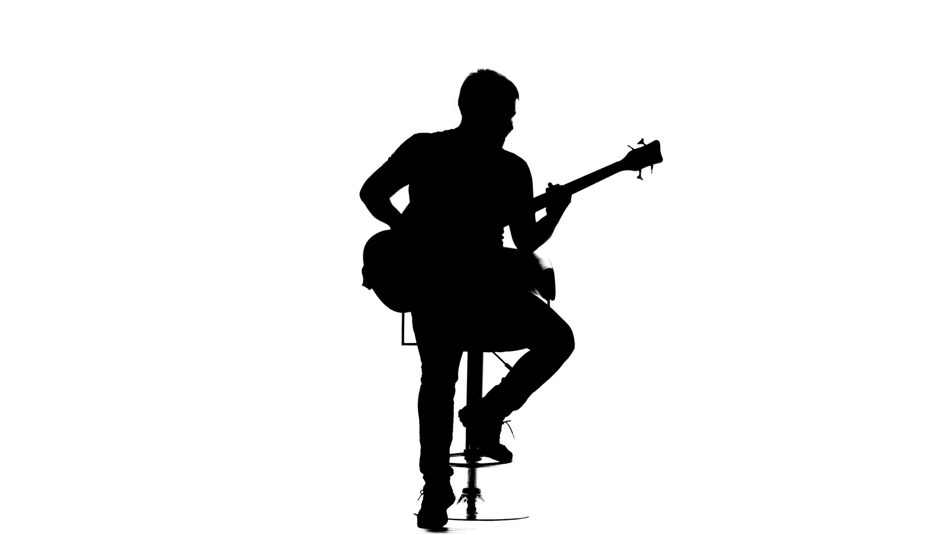 1920x1080 Man Plays Bass Guitar While Sitting On A Chair. Silhouette Stock