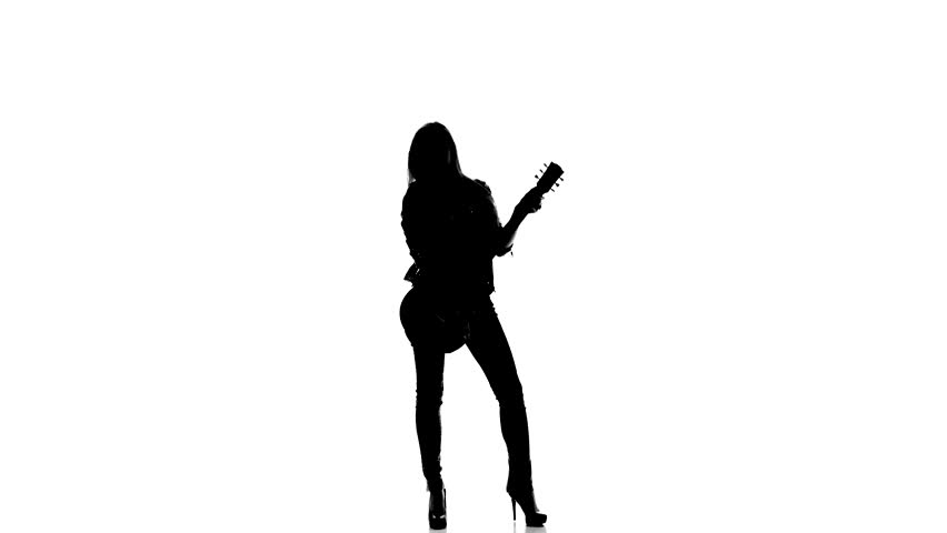 852x480 Silhouette Of A Young Girl Playing On Electric Guitar On A White