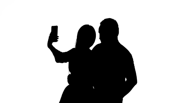 590x332 Guy And The Girl Are Making Selfies. Silhouette. White Background
