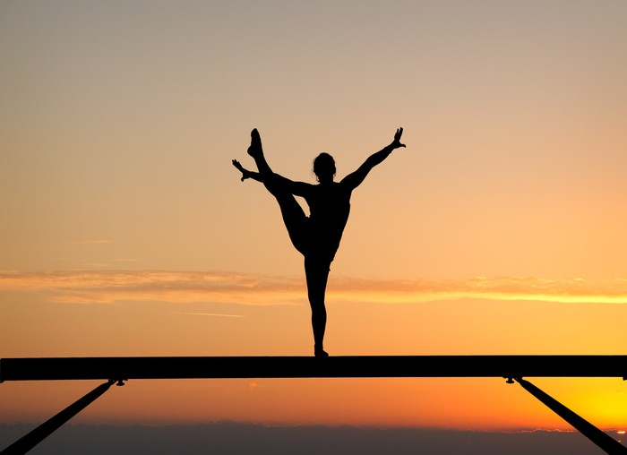 700x508 Silhouette Of Female Gymnast On Balance Beam In Sunset Wall Mural