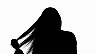 320x180 Silhouette Woman Brushing Hair Cu. A Woman Brushing Her Hair