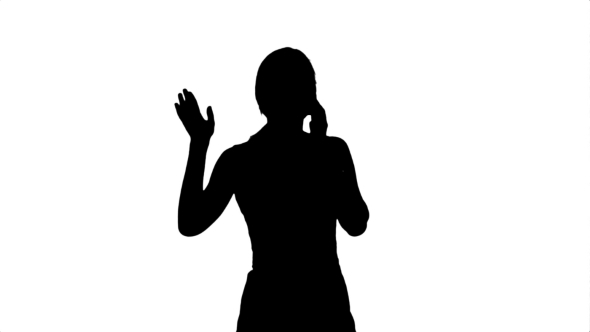 590x332 Silhouette Portrait Of Happy Young Woman Talking By Fancystudio