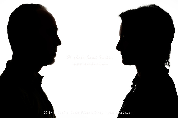 750x500 Silhouette Of Man And Woman Face To Face Sami Sarkis Stock Photo