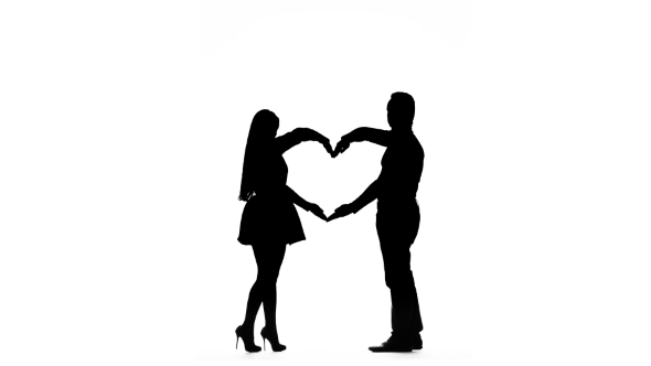590x332 Loving Couple Makes A Heart Shape With The Help Of Hands