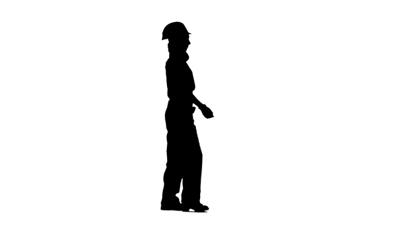 590x332 Girl Is Walking In A Helmet To Work. Silhouette By Kinomaster