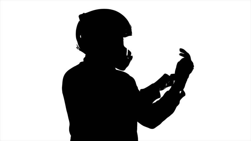 852x480 Man Wearing Helmet Puts On Gloves Stock Footage Video 1761632