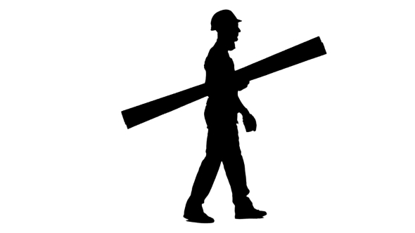 590x332 Silhouette Of Builder In A Helmet Goes To Work With Wooden Boards