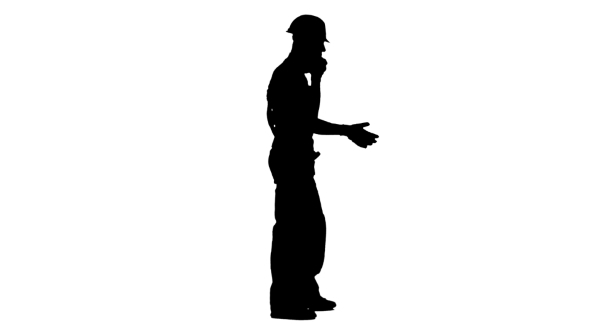 590x332 Silhouette Of Foreman In Helmet And Gloves Speaks Phone