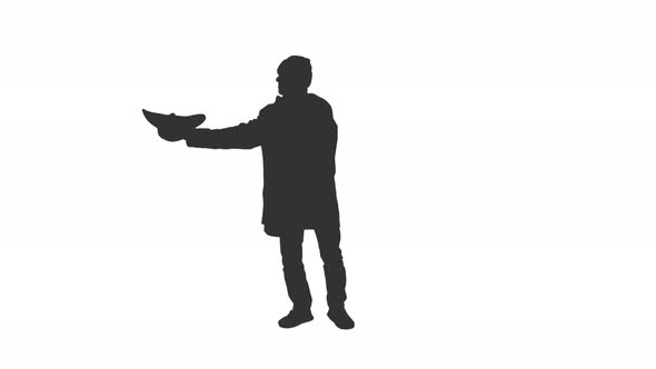 590x332 Silhouette Of A Homeless Man Begging In The Street, Alpha Channel