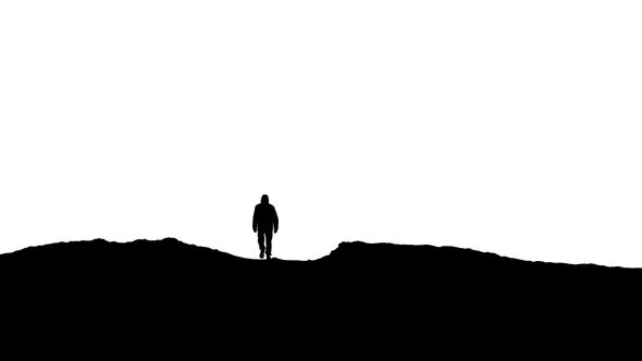 590x332 Man Walks Over Hill Silhouette By Rockfordmedia Videohive