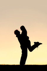 160x240 Silhouette Of Happy Young Couple Hugging Outside