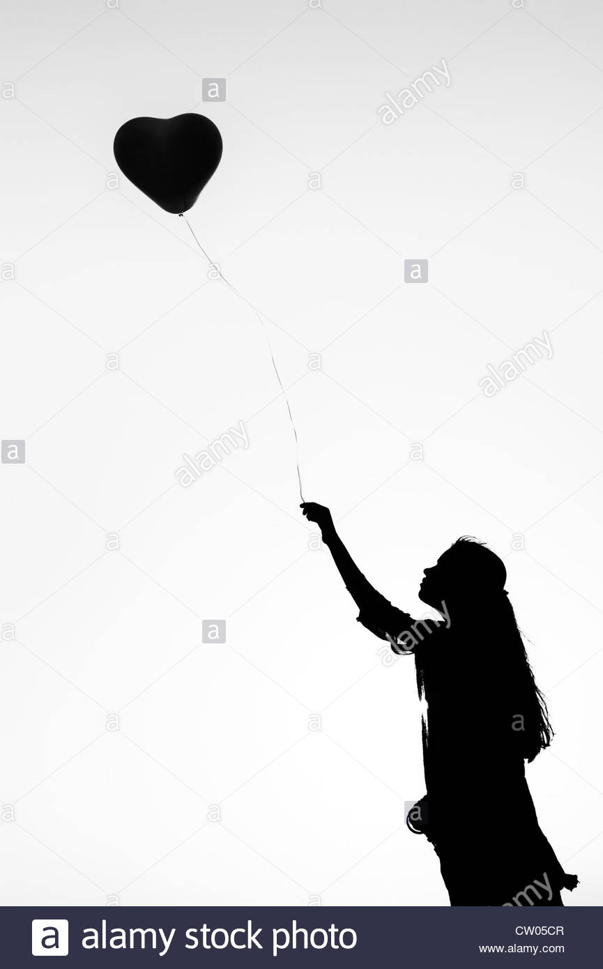 865x1390 Indian Teenage Girl Holding A Heart Shaped Balloon. Silhouette