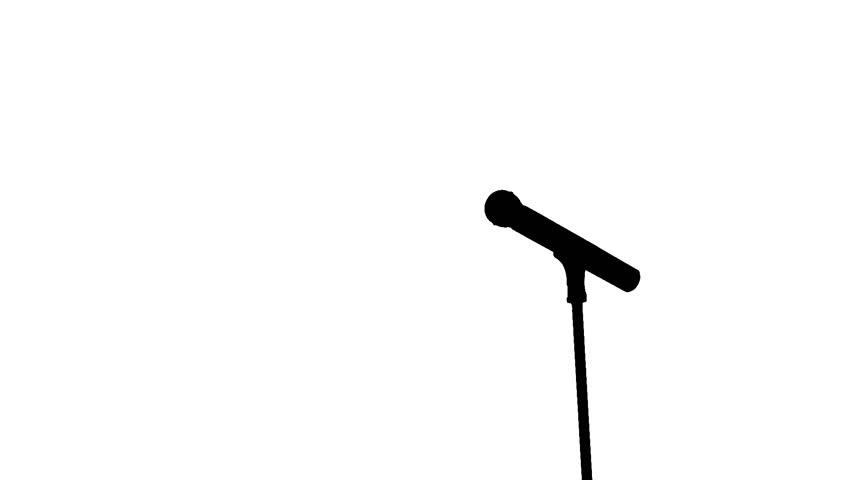852x480 Brutal Man Performs Song In Karaoke Club In Retro Microphone Stock