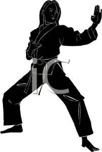 201x300 Of A Girl In A Backstance Doing A Block Wearing A Karate Uniform