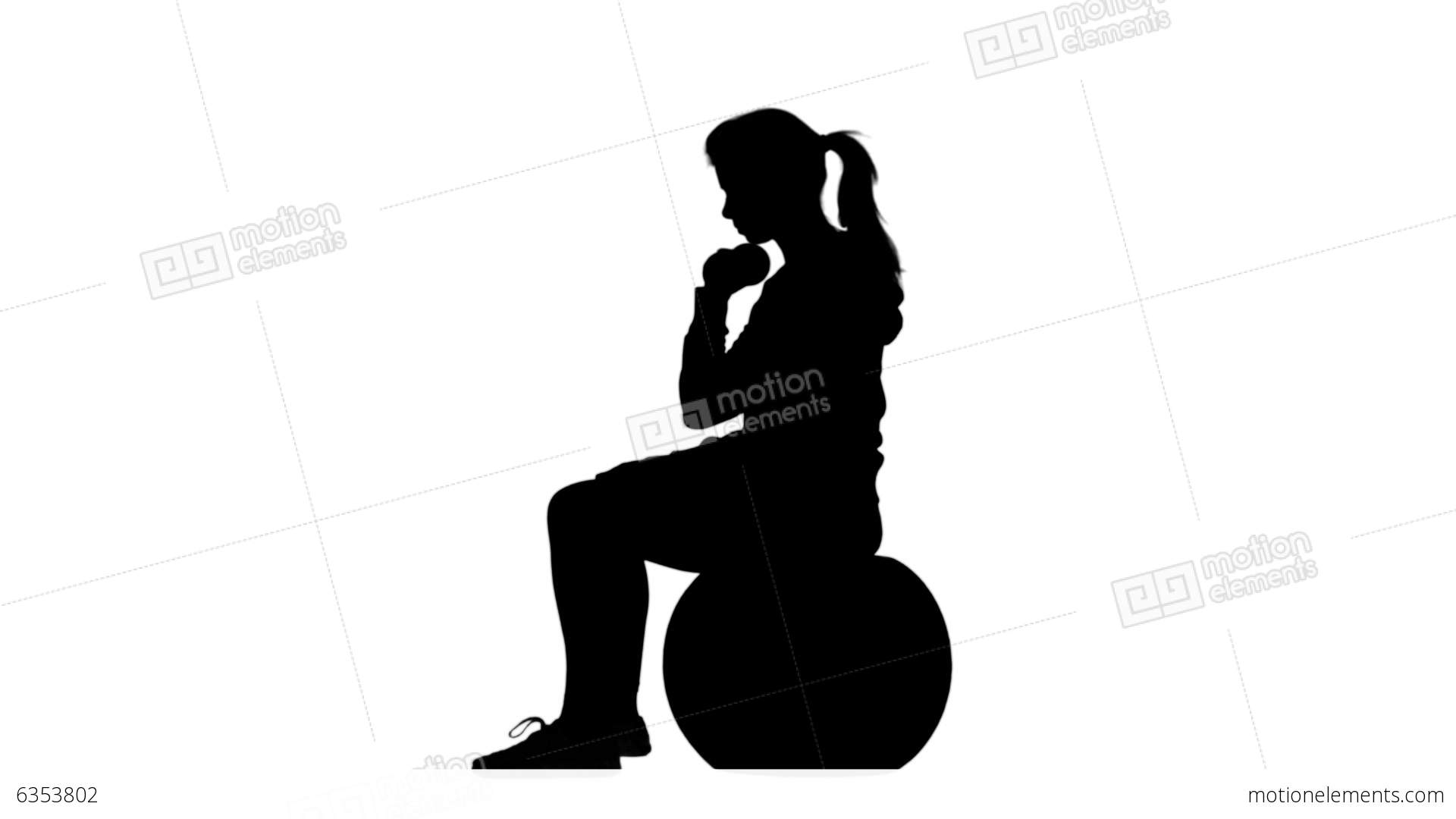1920x1080 Silhouette Of Woman Lifting Dumbbells On Exercise Ball Stock Video