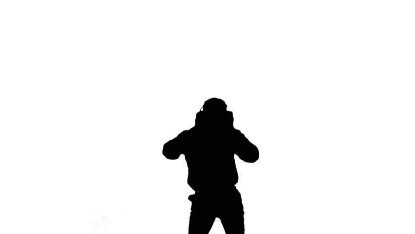 852x480 Silhouette Of A Man Jumping And Listening To Music On White